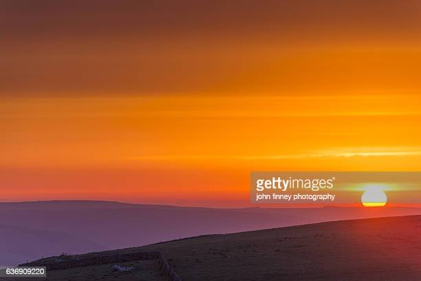 Sunrise sky over the rolling hills of the English Peak District. UK.
