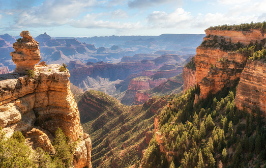 Sunrise spilling into the Grand Canyon at Desert View road pull over 968540320