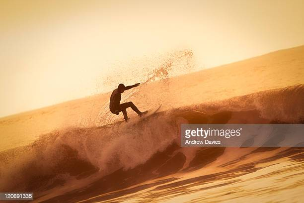 sunrise surf - gower peninsula stock photos and pictures
