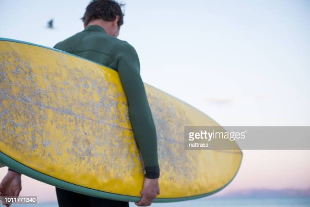 sunrise surf session in cape town - only mid adult men stock pictures, royalty-free photos & images