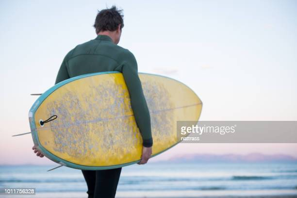sunrise surf session - only mid adult men stock pictures, royalty-free photos & images