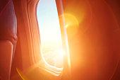 Sunrise through a plane window.