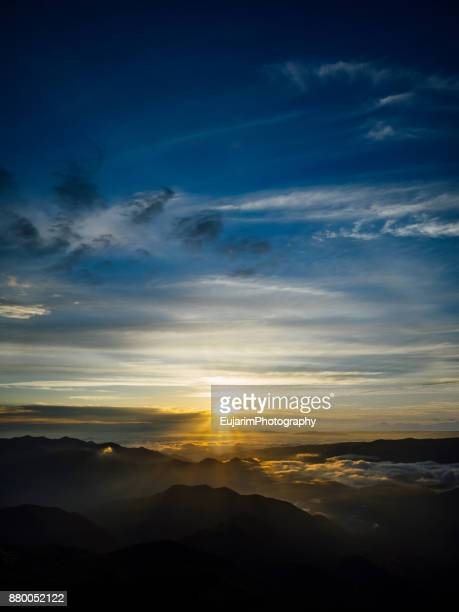 Sunrise under cloudy sky at Mount Norikura