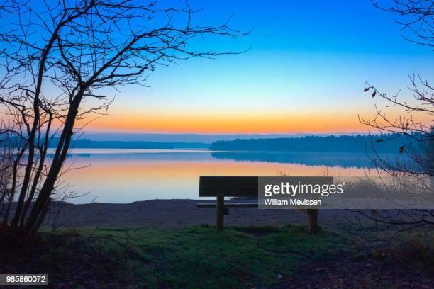 sunrise view 'bench' - william mevissen stockfoto's en -beelden
