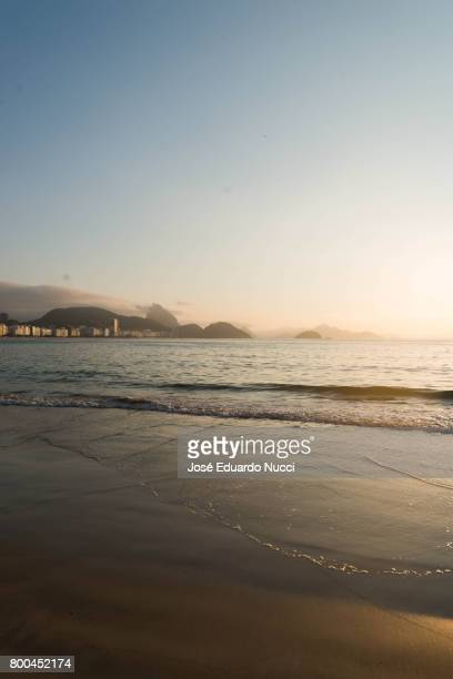 sunrise view from copacabana beach - march month stock photos and pictures