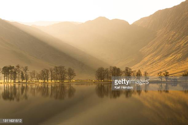 a sunrise view of buttermere lake in the lake district, cumbria - stock photo - dawn stock pictures, royalty-free photos & images