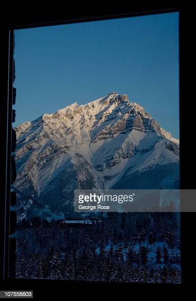 A sunrise view of Cascade Mountain from a Fairmont Banff Springs Hotel suite on November 22 2010 in Banff Springs Canada The famed hotel built by the...