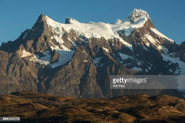Sunrise view of Cerro Paine Grande taken from Hosteria Pehoe island At left on the mountain is Punta Bariloche then the Central Summit with the Main...