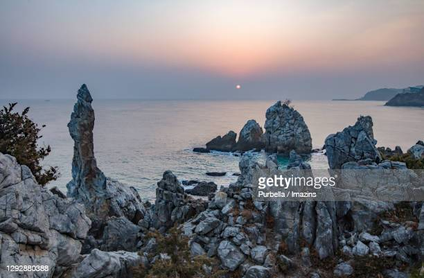 sunrise view of chotdae rock, donghae, south korea - gangwon province stock pictures, royalty-free photos & images