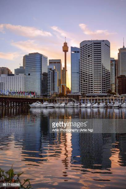 sunrise view of cockle bay wharf in darling harbour and sydney tower eye, new south wales, australia - darling harbour stock pictures, royalty-free photos & images