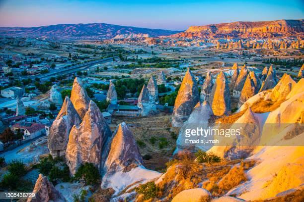 sunrise view of fairy chimneys in göreme, turkey - カッパドキア ストックフォトと画像