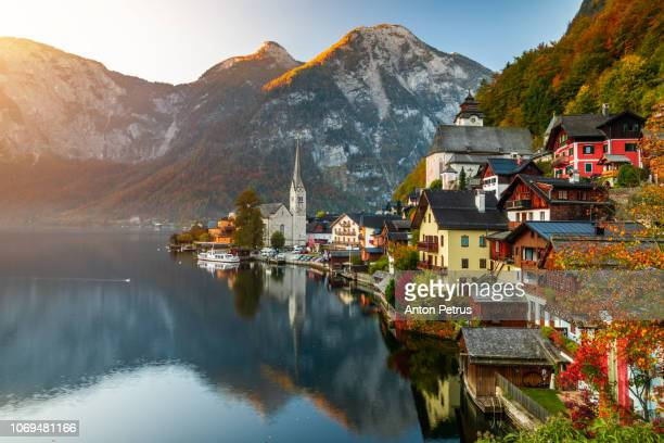 sunrise view of famous hallstatt mountain village with hallstatter lake, austria - austria stock pictures, royalty-free photos & images