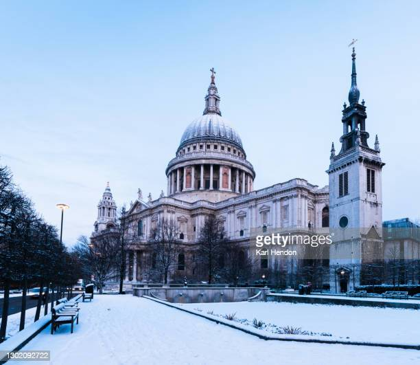 a sunrise view of london's st.paul's cathedral in the snow - stock photo - winter stock pictures, royalty-free photos & images