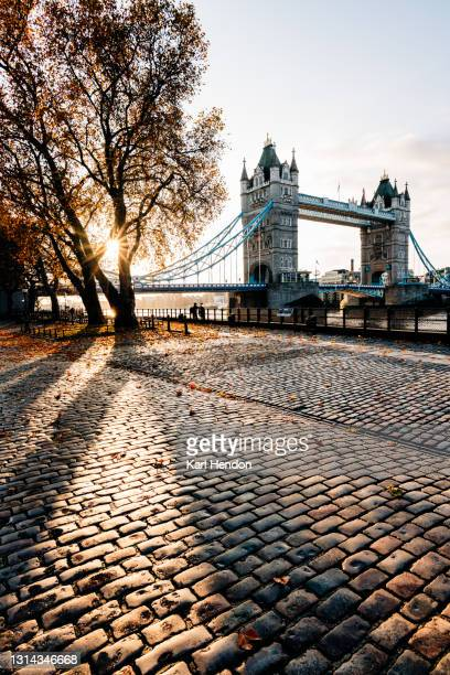 a sunrise view of london's tower bridge - stock photo - london stock pictures, royalty-free photos & images