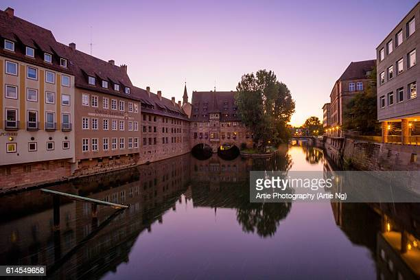 Sunrise View of Pegnitz River and the Hospice of the Holy Spirit (Heilig-Geist-Spital), Nuremberg, Middle Franconia, Bavaria, Germany