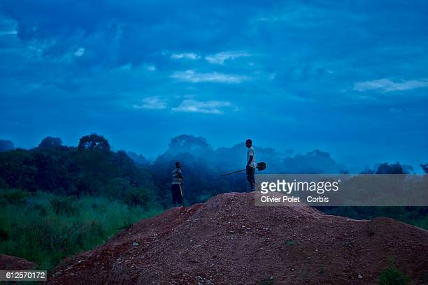 A sunrise view of the workers equipped with shovels and iron bars as they arrive at the 7/7 diamond mining site outside an Angolan village near the...