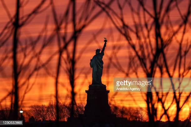 Sunrise view over the Statue of Liberty is seen from Liberty State Park in Jersey City, New Jersey, United States on January 11, 2021.