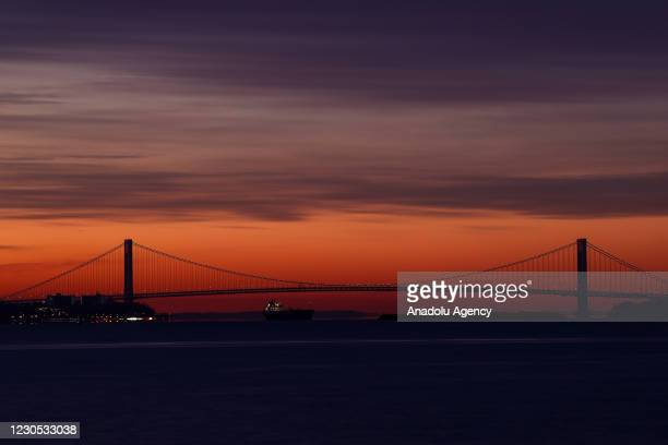 Sunrise view over the Verrazzano-Narrows Bridge is seen from Liberty State Park in Jersey City, New Jersey, United States on January 11, 2021.