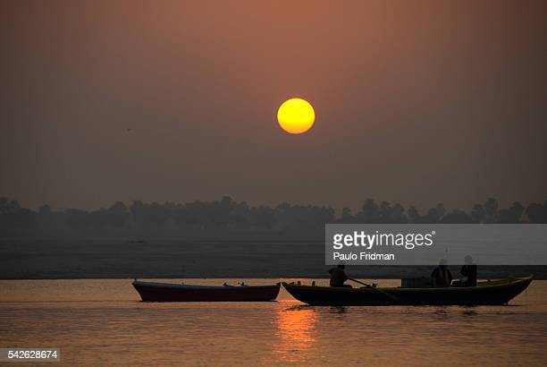 Sunrise viewed from the Ganges river in Varanasi Uttar Pradesh India