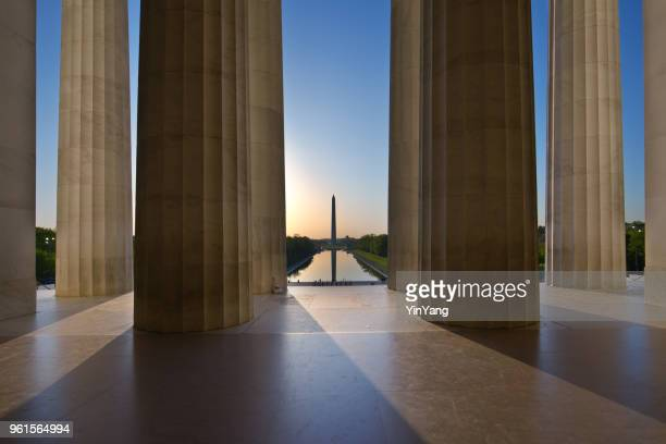 sunrise washington monument viewed from lincoln memorial in washington dc, usa - national monument stock pictures, royalty-free photos & images