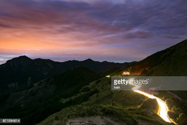 Sunrise with dramatic sky and Lighting Car Trace