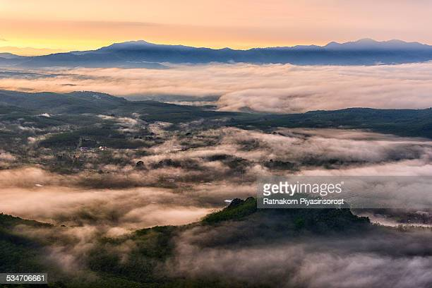 sunrise with foggy landscape, thailand - hat yai foto e immagini stock