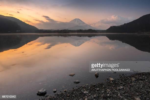 Sunrise with Mt.fuji on the reflection lake , Shojiko lake , Yamanashi , Japan