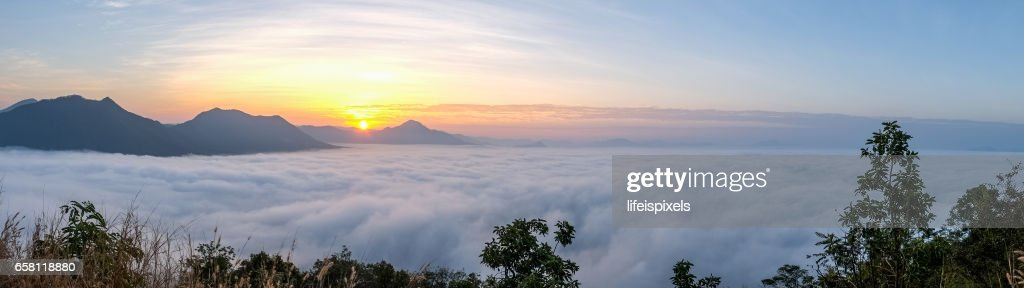 Sunrise with sea of fog over Phu Thok Mountain at Chiang Khan, Thailand : Stock Photo