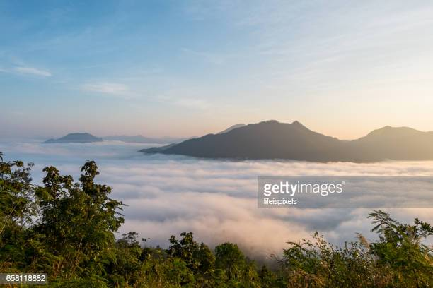 Sunrise with sea of fog over Phu Thok Mountain at Chiang Khan, Thailand