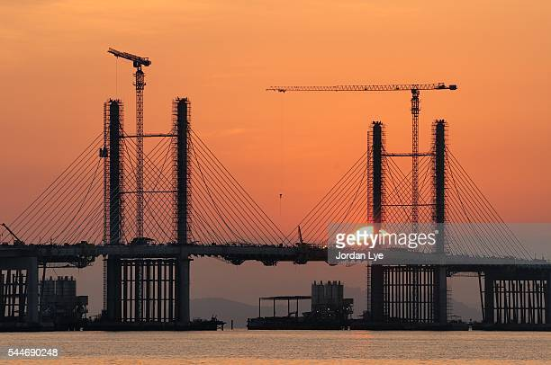 Sunrise with under construction bridge