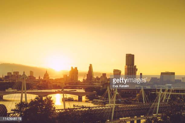 sunrising over the city of london - city of london stock pictures, royalty-free photos & images