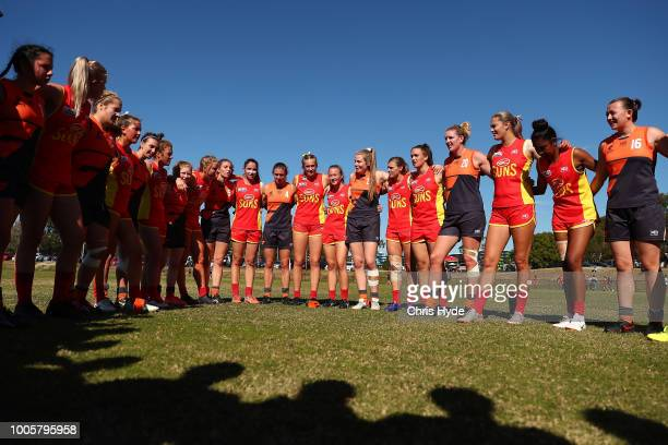 Suns and Giants huddle after the Giants won the round two AFLW Winter Series match between the Gold Coast Suns and the Southern Giants at Southport...