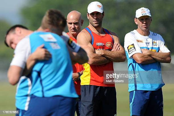 Suns assistant coach Dean Solomon and Titans assistant coach Steve Murphy look on during a Gold Coast Titans training session at Metricon Stadium on...