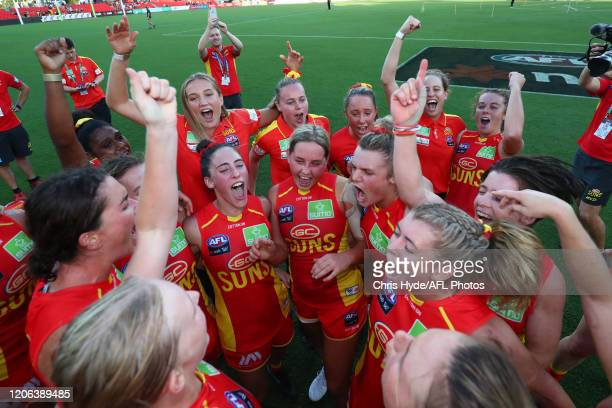 Suns celebrate winning the round 2 AFLW match between the Gold Coast Suns and the Richmond Tigers at Metricon Stadium on February 15, 2020 in Gold...