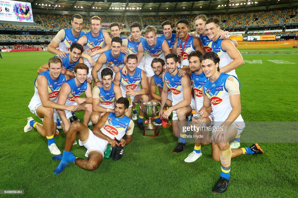 Suns celebrate winnning the Q Clash during the round five AFL match between the Brisbane Lions and the Gold Coast Suns at The Gabba on April 22, 2018 in Brisbane, Australia.