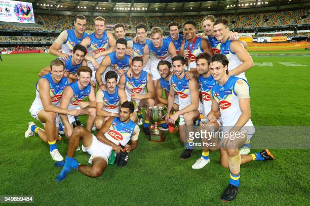 Suns celebrate winnning the Q Clash during the round five AFL match between the Brisbane Lions and the Gold Coast Suns at The Gabba on April 22 2018...