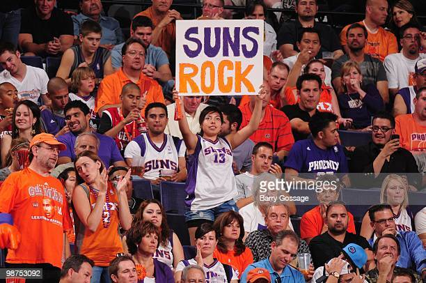 Suns fan holds a poster as the Phoenix Suns take on the Portland Trail Blazers in Game Five of the Western Conference Quarterfinals during the 2010...