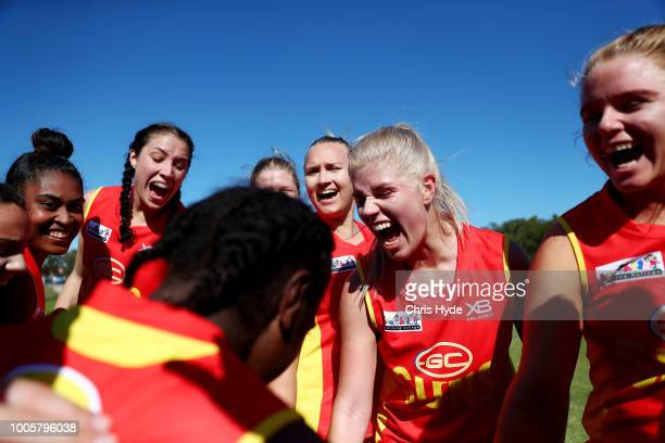 Suns huddle before the round two AFLW Winter Series match between the Gold Coast Suns and the Southern Giants at Southport on June 24 2018 in Gold...