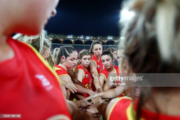 Suns huddle during the AFLW Winter Series match between the Gold Coast Suns and the Brisbane Lions at Metricon Stadium on July 14 2018 in Gold Coast...
