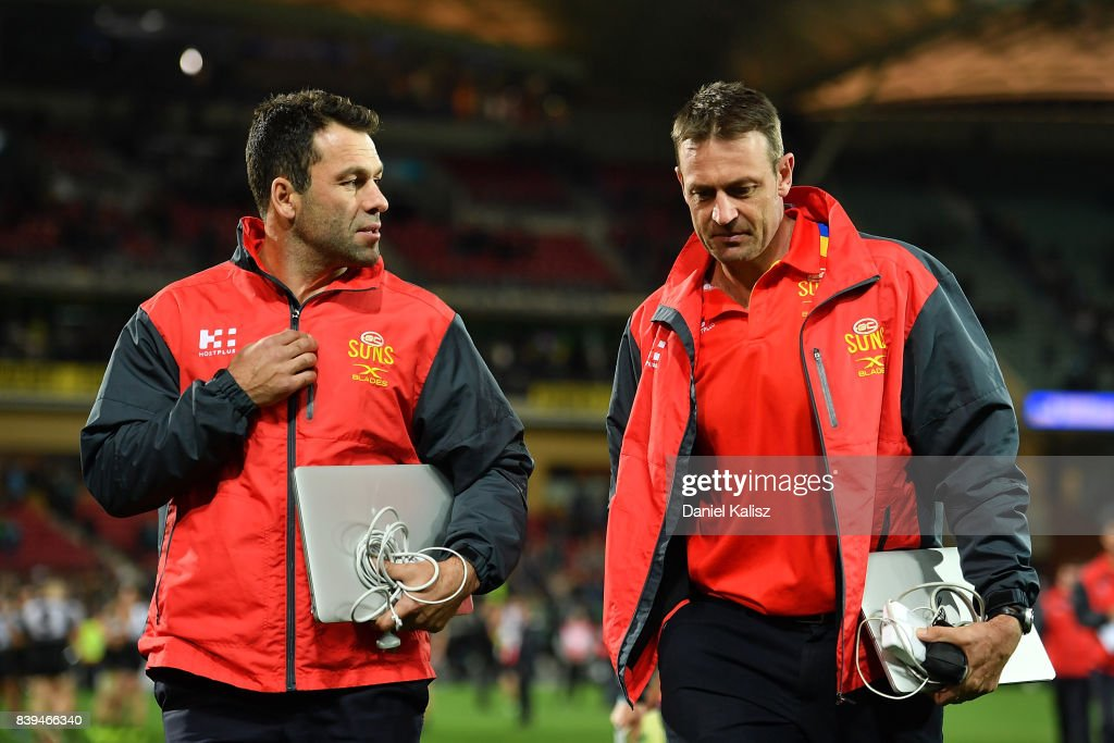 Suns interim head coach Dean Solomon and Suns assistant coach Matthew Primus walk from the field after during the round 23 AFL match between the Port Adelaide Power and the Gold Coast Suns at Adelaide Oval on August 26, 2017 in Adelaide, Australia.