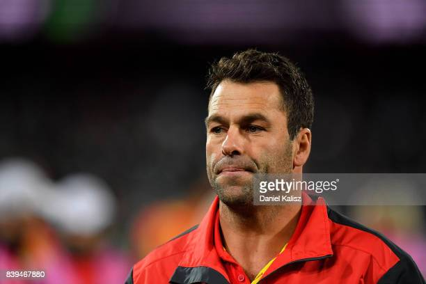 Suns interim head coach Dean Solomon walks from the field at three quarter time during the round 23 AFL match between the Port Adelaide Power and the...