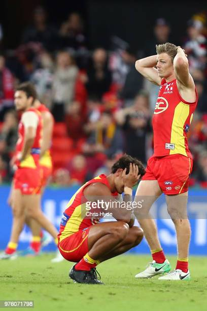 Suns look on after losing the round 13 AFL match between the Gold Coast Suns and the St Kilda Saints at Metricon Stadium on June 16, 2018 in Gold...