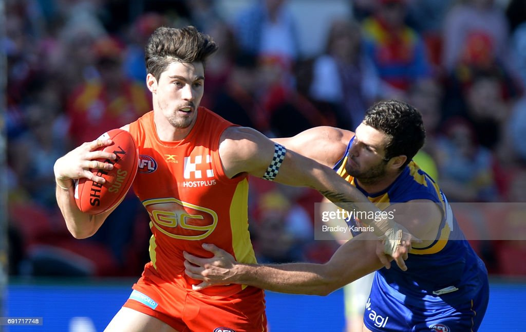 Suns player Alex Sexton attempts to break away from the defence of West Coast Eagles player Jack Darling challenge for the ball during the round 11 AFL match between the Gold Coast Suns and the West Coast Eagles at Metricon Stadium on June 3, 2017 in Gold Coast, Australia.