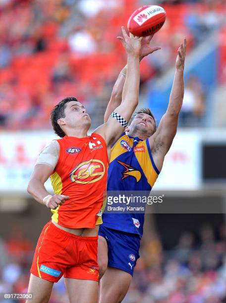 Suns player Kade Kolodjashnij and West Coast Eagles player Mark Lecras challenge for the ball during the round 11 AFL match between the Gold Coast...