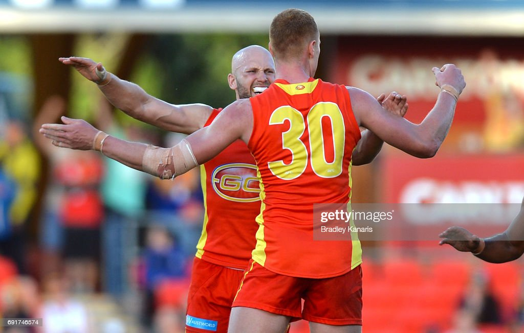Suns player Peter Wright celebrates with team mate Gary Ablett after kicking the winning goal during the round 11 AFL match between the Gold Coast Suns and the West Coast Eagles at Metricon Stadium on June 3, 2017 in Gold Coast, Australia.