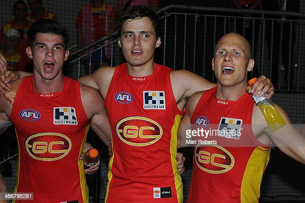 Suns players Jaeger O'Meara Kade Kolodjashnij and Gary Ablett celebrate victory after the round six AFL match between the Gold Coast Suns and the...