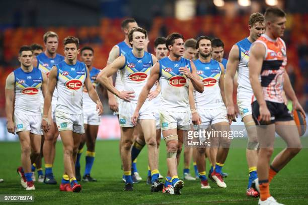 Suns players look dejected after the round 12 AFL match between the Greater Western Sydney Giants and the Gold Coast Suns at Spotless Stadium on June...