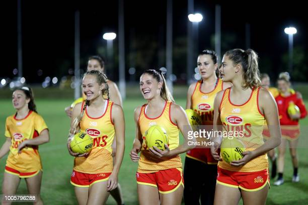 Suns players talk during a training session ahead of the round two AFLW Winter Series match between the Gold Coast Suns and the Southern Giants at...