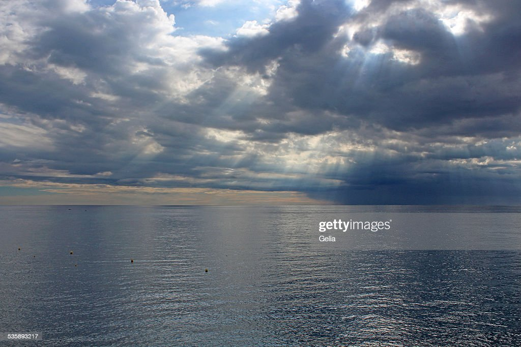 Sun's rays passing through the storm clouds : Stock Photo