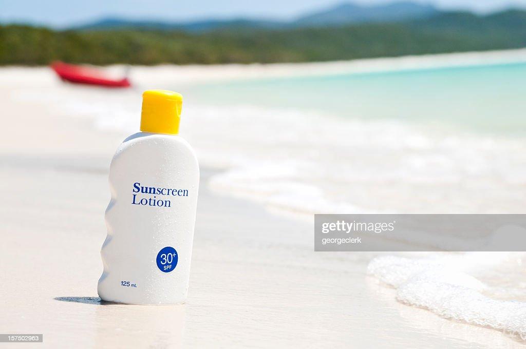 Sunscreen lotion on the beach : Stock Photo